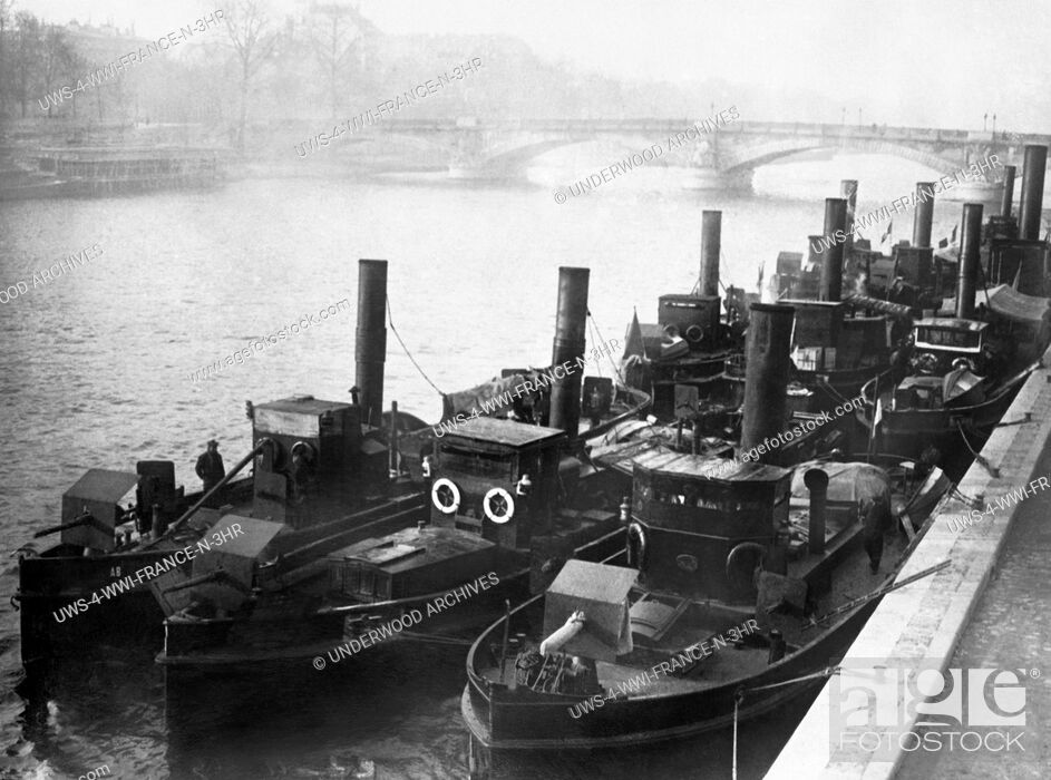 Stock Photo: Paris, France: January 21, 1915 Armored tug boats guard the River Seine from possible attacks by German forces.