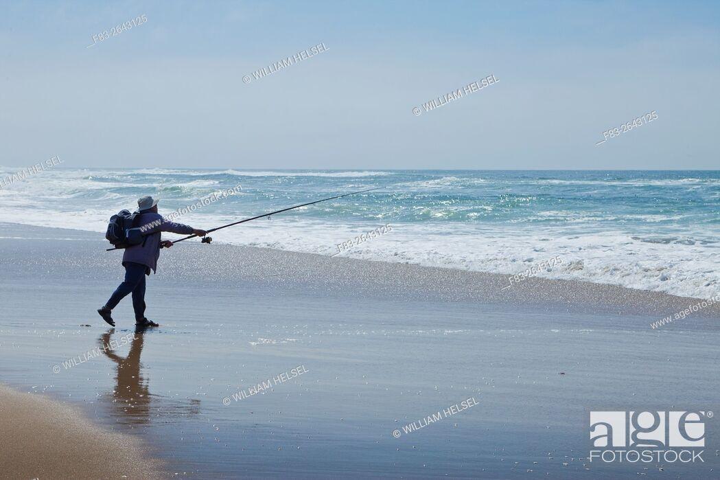 Stock Photo: Surf fisherman casting on state beach, Santa Barbara County, CA, USA.