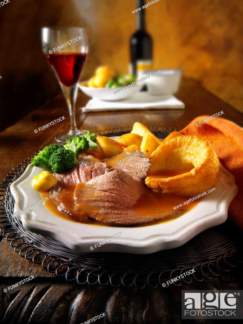Stock Photo: Roast beef Yorkshire pudding and gravy.