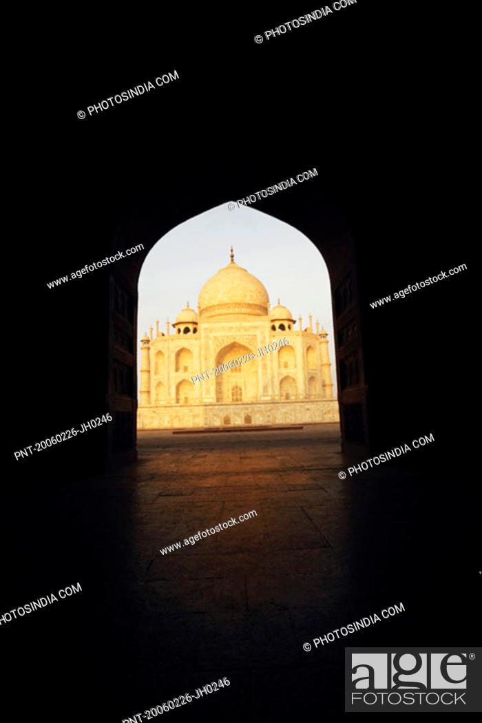 Stock Photo: Mausoleum viewed through an archway, Taj Mahal, Agra, Uttar Pradesh, India.