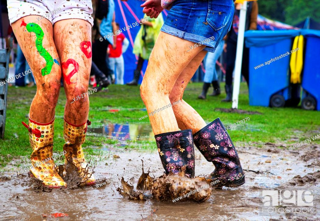 Stock Photo: Utrecht, Netherlands, girls having fun while dancing and splashing in the rain.