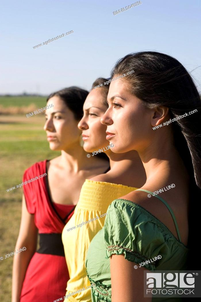 Stock Photo: Row of multi-ethnic women in sunlight.