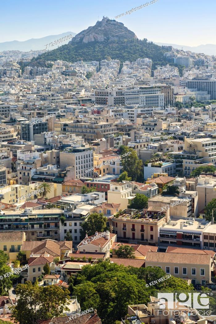 Stock Photo: Athens, Attica, Greece. View over Athens from the Acropolis to 277 meter high Mount Lycabettus (Lycabettos or Lykabettos or Lykavittos) crowned by the Chapel of.