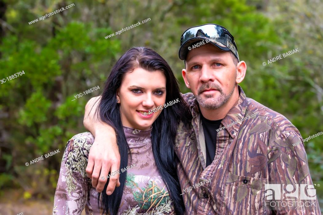 Stock Photo: Two hunters portrait, father and daughter in camouflage outfit, male Caucausian, 40 years old, female Caucasian with long black hair, 18 years old, Texas, USA.
