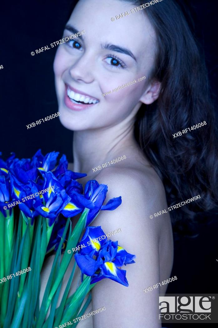 Stock Photo: young woman with banch of irises.