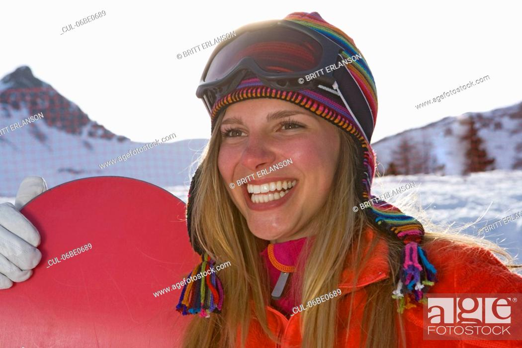 Stock Photo: Girl ski smiling with ski board.