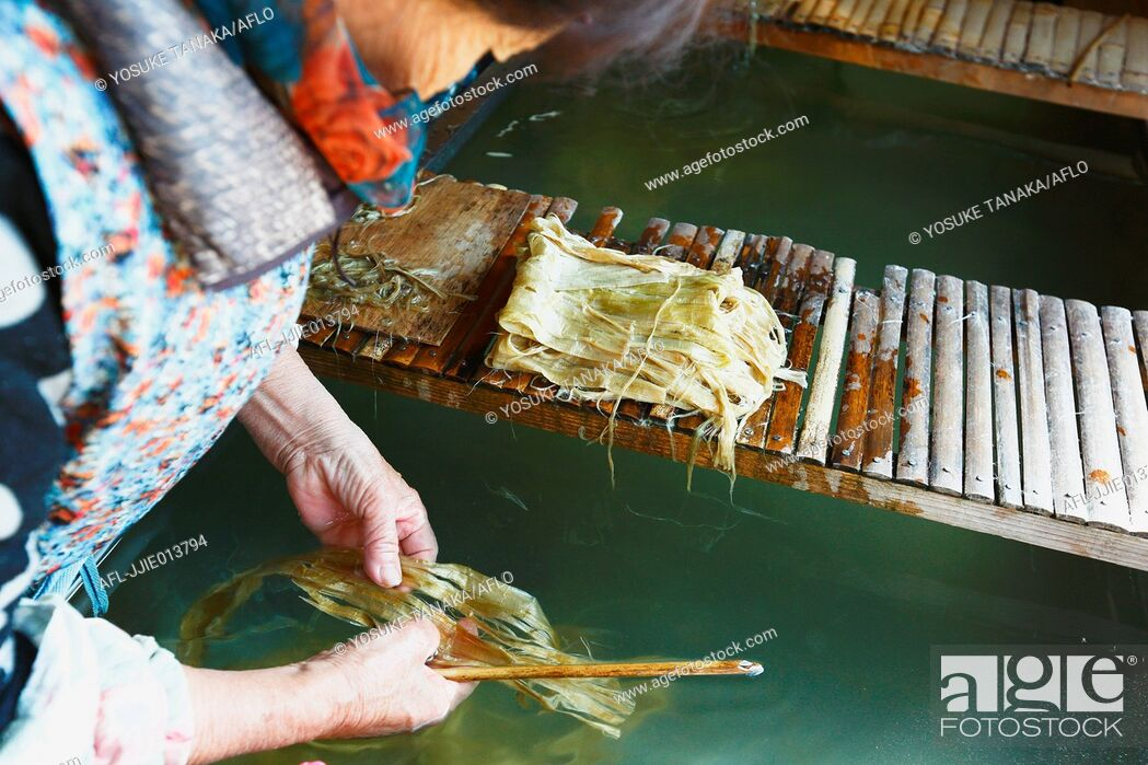 Stock Photo: Japanese traditional paper craftsman working in her studio.