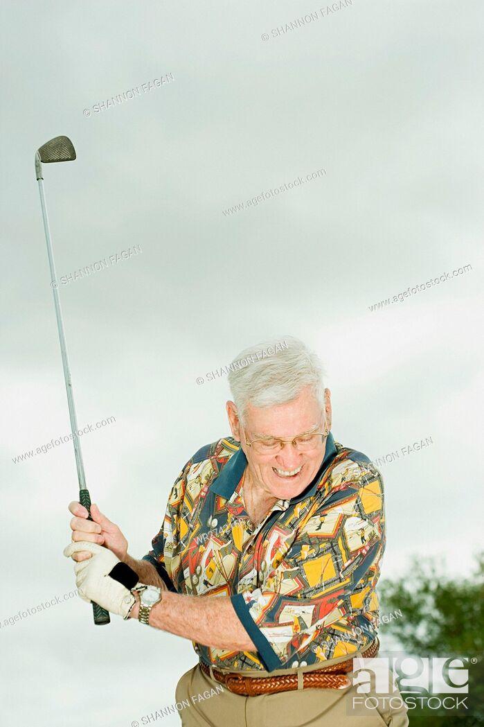Stock Photo: Senior man playing golf.
