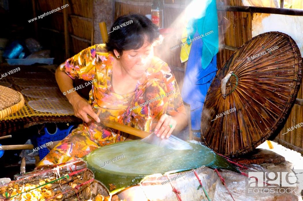 Stock Photo: Vietnam - The South - The Delta of Mekong - Vinh Long - Gastronomy - Preparation of rice crepes.