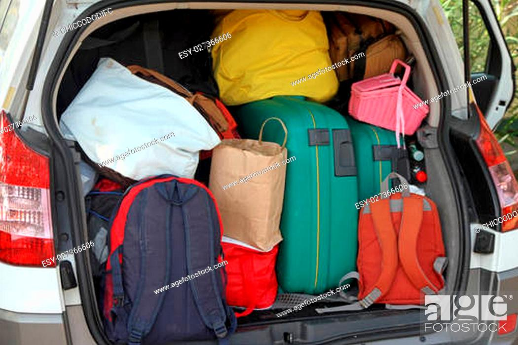 Stock Photo: Car full of suitcases and bags to return from summer holidays.