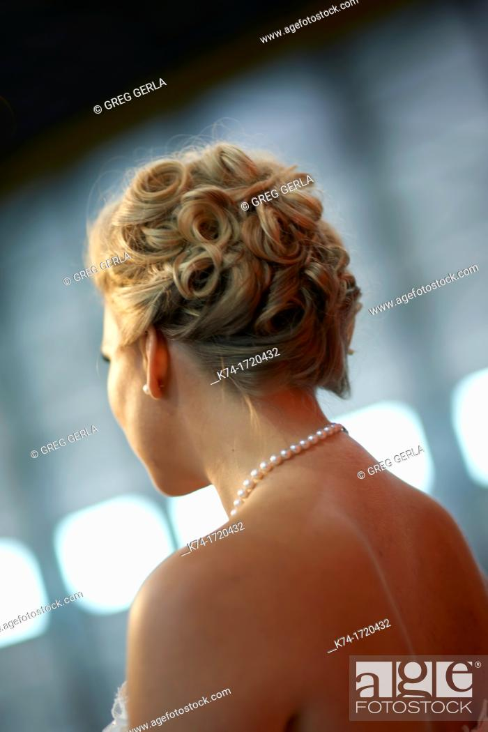 Stock Photo: Photograph of a bride's back with pearl necklace.