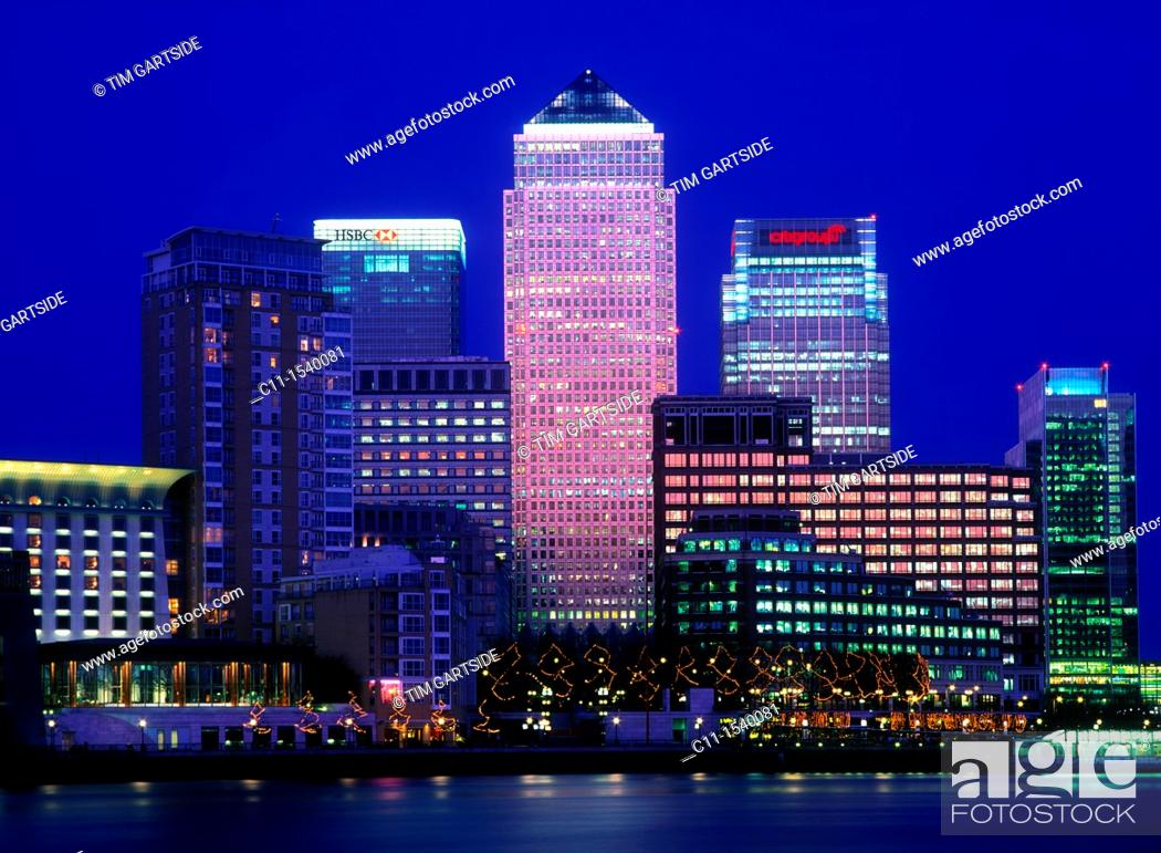 Stock Photo: canary wharf isle of dogs from across river thames dusk sunset london england uk.