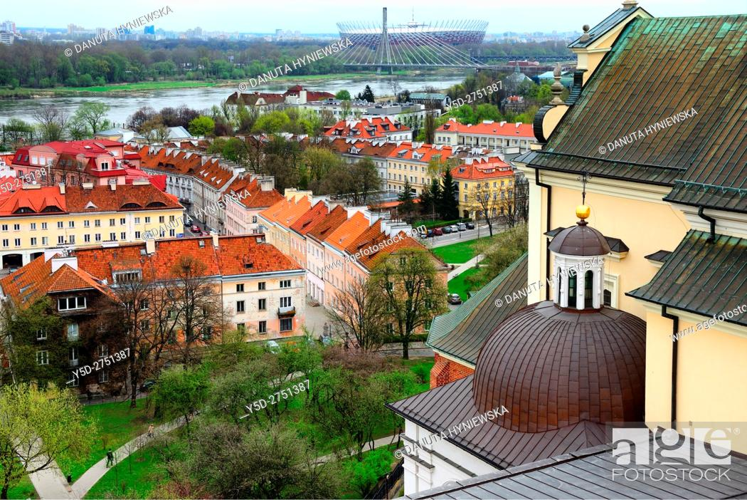 Stock Photo: on right Kosciol Akademicki Sw. Anny - St Anne's Church at Castle Square, view for Mariensztat - smallest district of Warsaw located between the Vistula river.