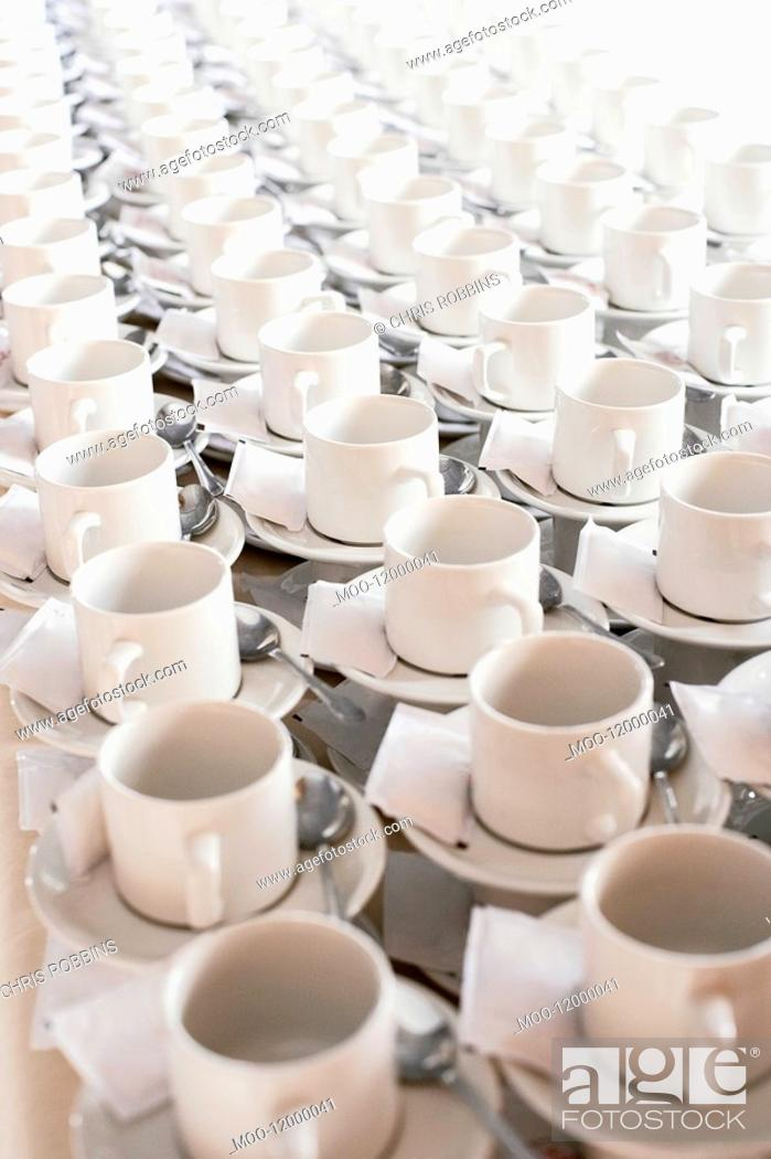 Stock Photo: Rows of stacked teacups and saucers elevated view.
