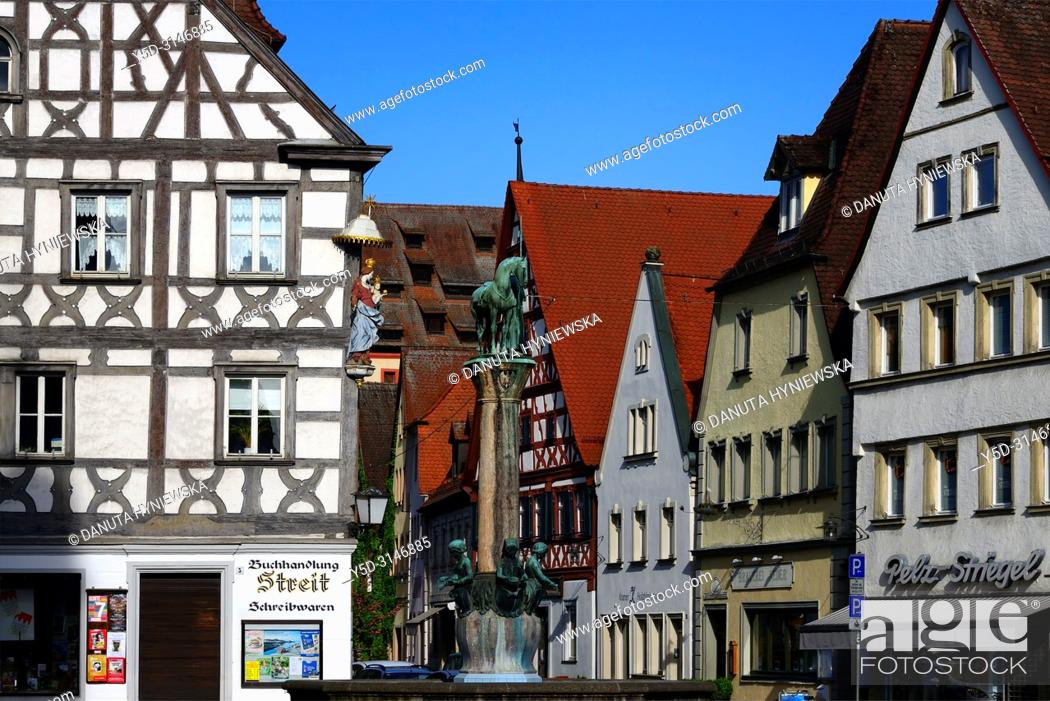 Stock Photo: View for facades at Sattlertorstrasse from the town hall square, in front on left historic timber house with statue of Virgin Mary.
