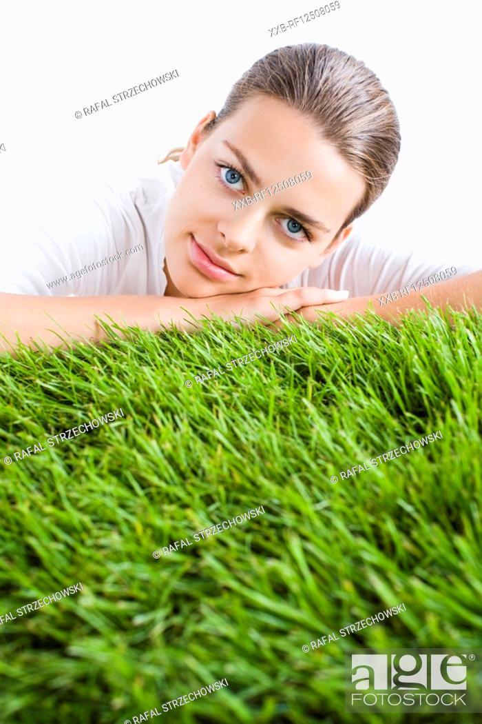 Stock Photo: beauty woman laying on grass.
