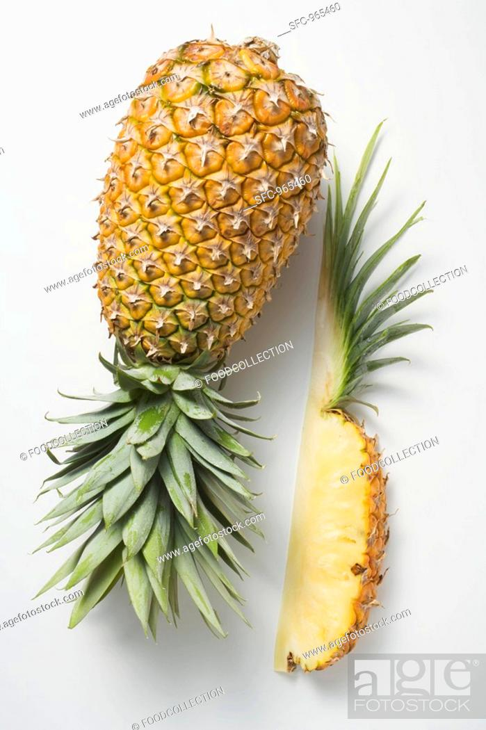 Stock Photo: Whole pineapple with wedge of pineapple.