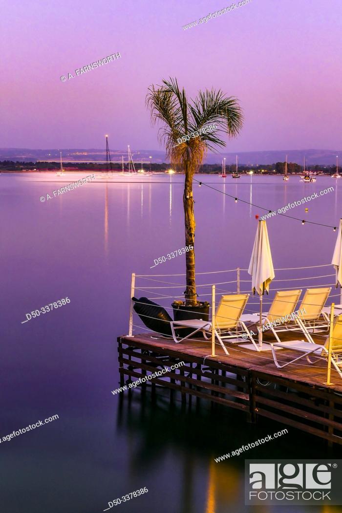 Stock Photo: Syracuse, Sicily, Italy An outdoor terrace in the harbor on Ortygia island.