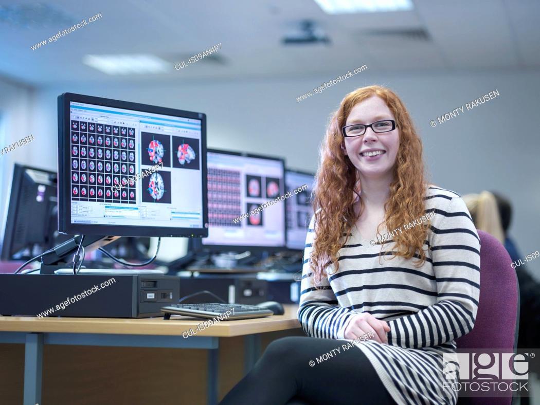 Stock Photo: Neuroimaging student at workstation, portrait.