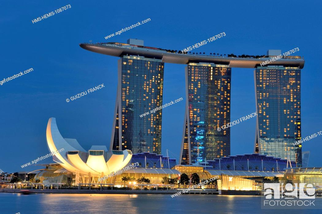Stock Photo: Singapore, Marina Bay, the hotel Marina Bay Sands opened in 2010 and the ArtScience Museum lotus flower shaped opened in 2011, by the architect Moshe Safdie.
