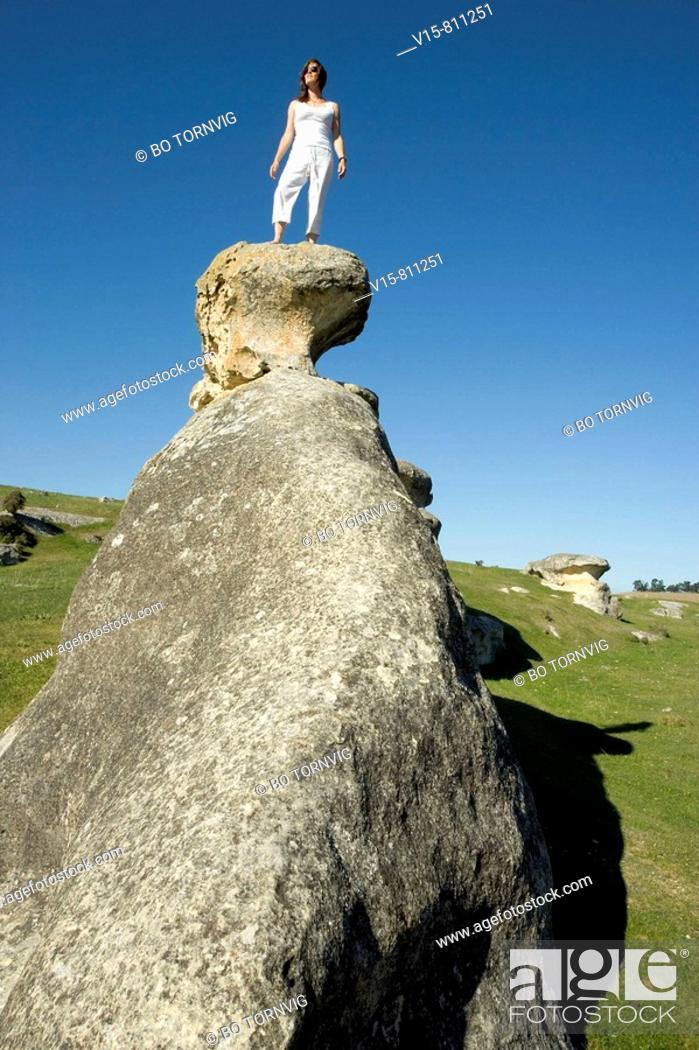 Stock Photo: woman standing on rock.