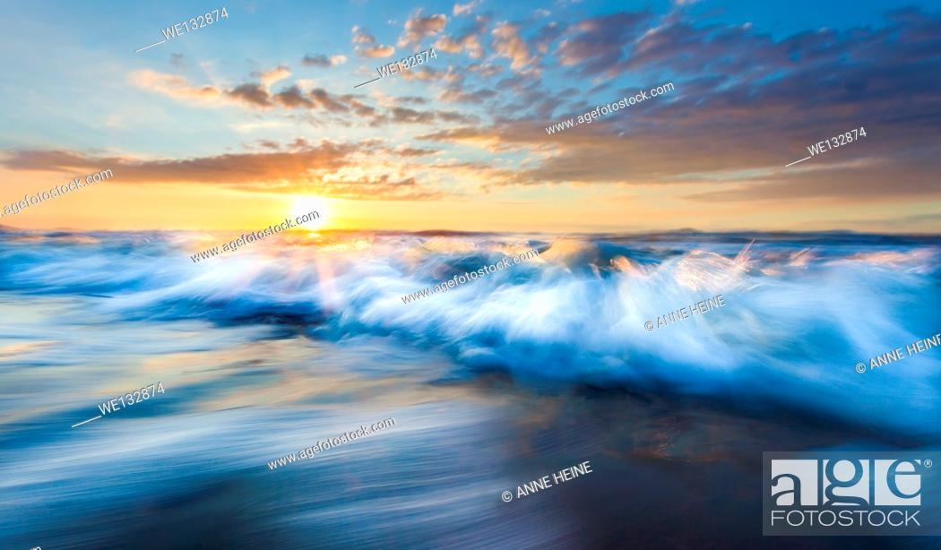 Stock Photo: Breakwater, long exposure and wde angle, pulled tripod out of water just before the wave came in.