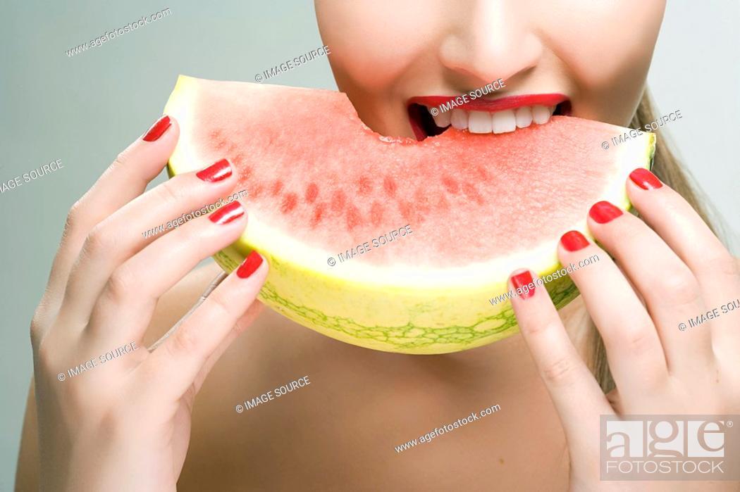 Stock Photo: Woman eating watermelon.