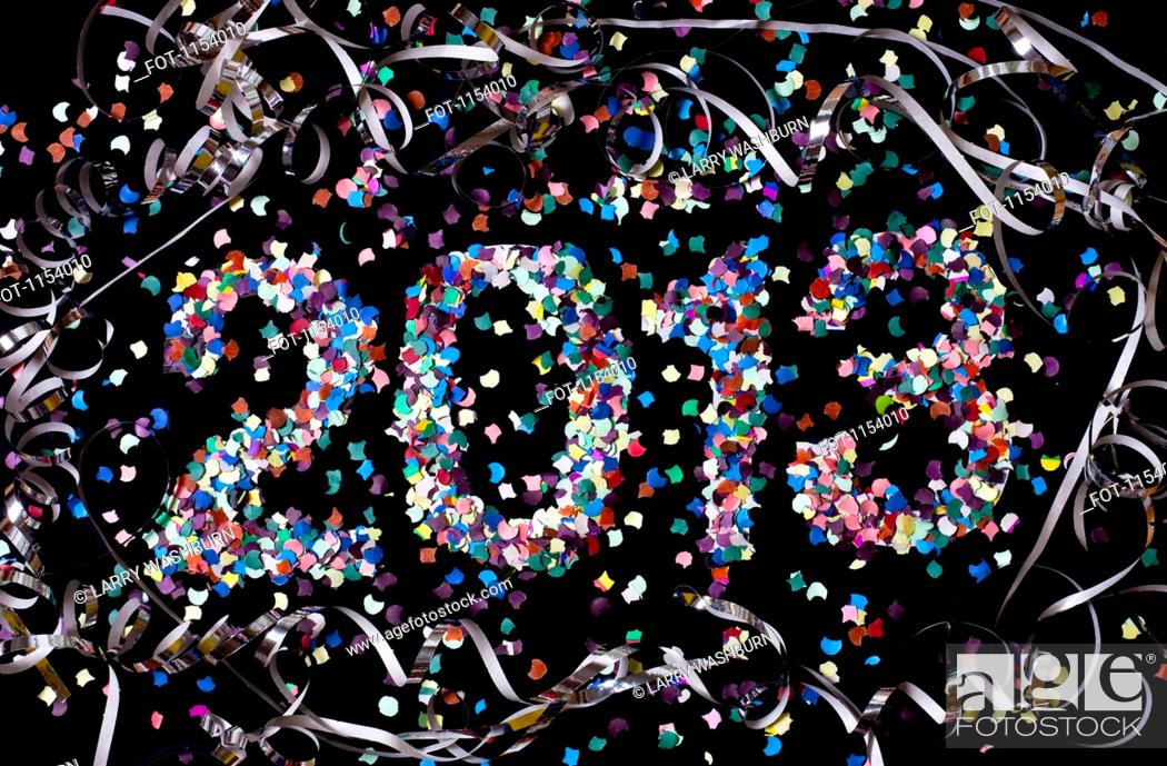 Stock Photo: The year 2013 spelled out with confetti and surrounded by streamers.