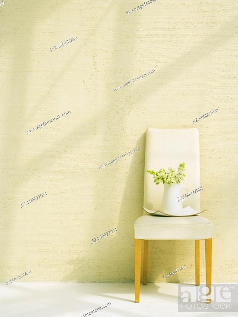 Stock Photo: Lilac in white china pot on chair.