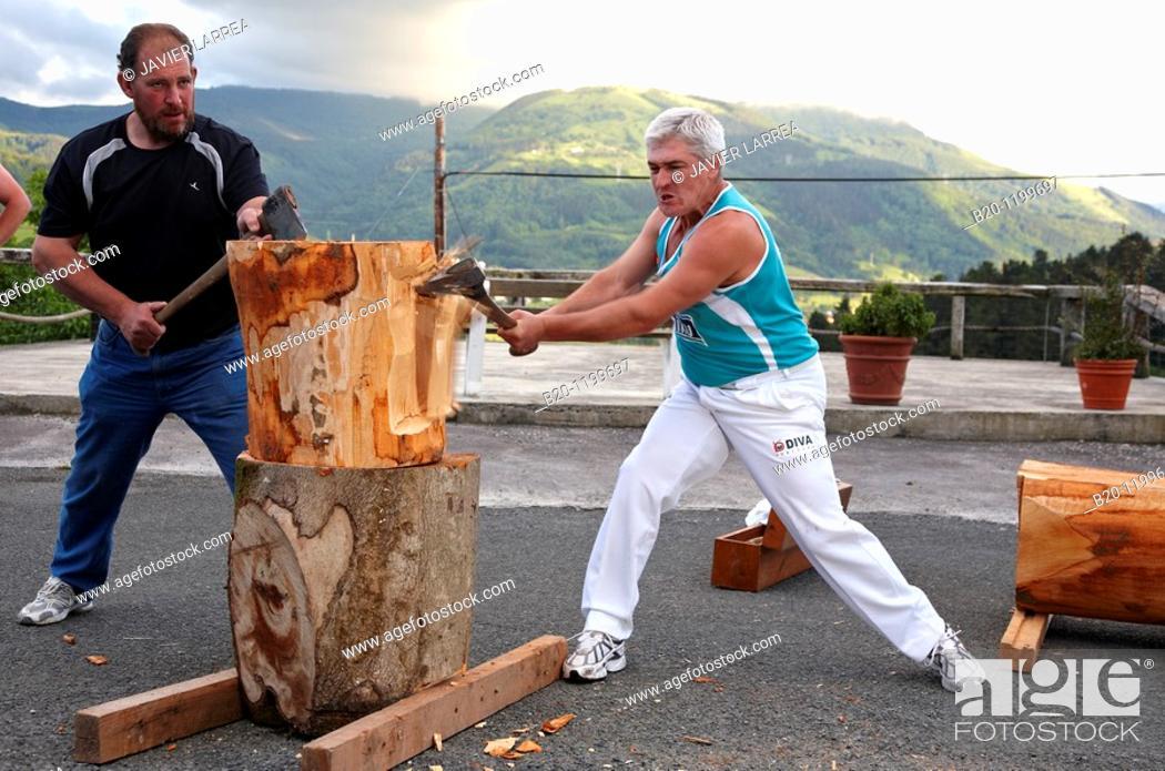 Stock Photo: Luis Txapartegi, Aizkolari (wood-chopping), and Iñaki Perurena, Basque rural sport, Aduna, Gipuzkoa, Basque Country, Spain.