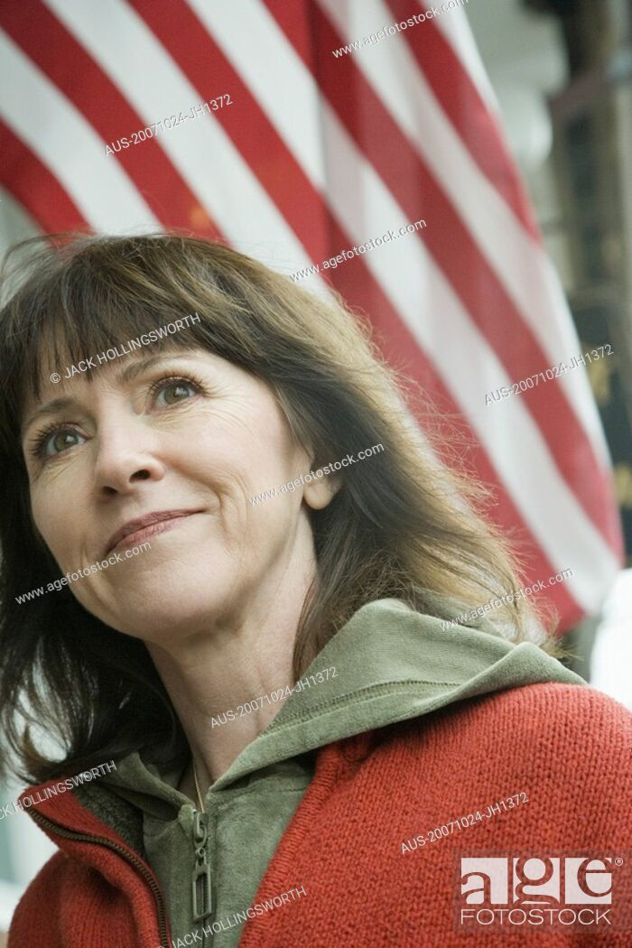 Stock Photo: Low angle view of a mature woman smiling.