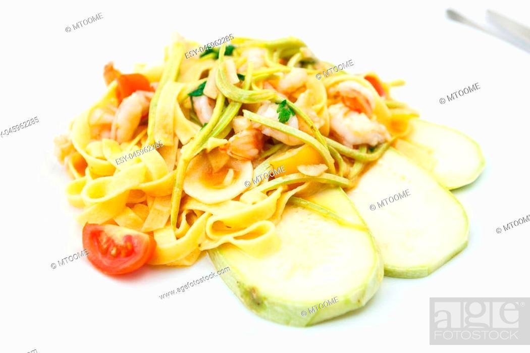 Stock Photo: Tagliatelle with tiger prawns, tomatoes and zucchini.