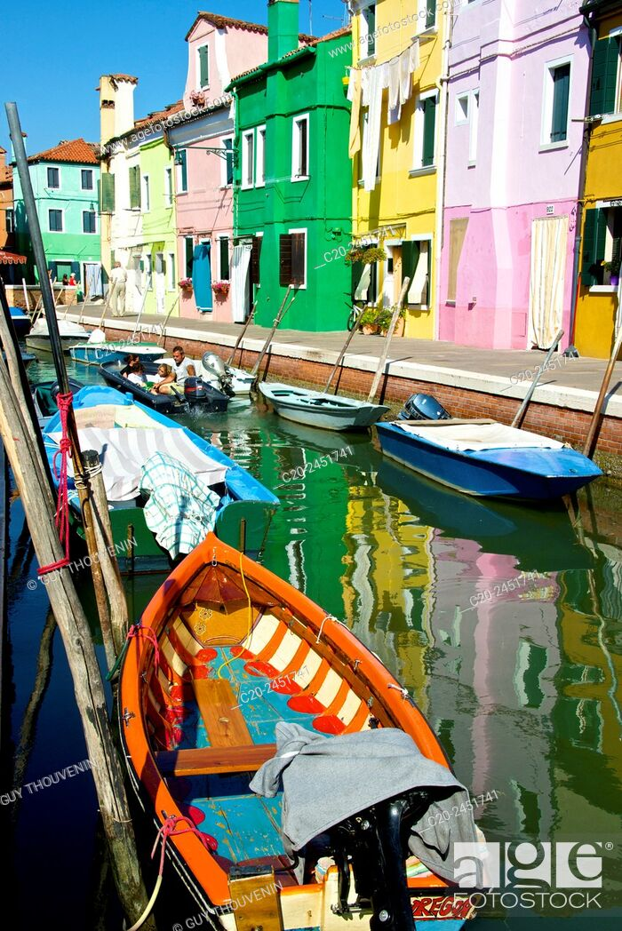 Stock Photo: Colored Fishing boats, canal, Drying clothes, colored facades, Burano island, Venice, Venetia, Italy.