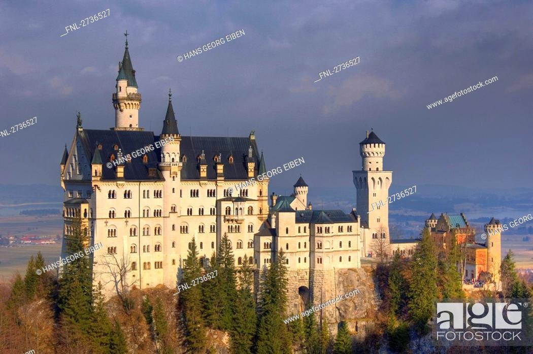 Stock Photo: Trees in front of castle, Neuschwanstein Castle, Allgaeu, Bavaria, Germany.