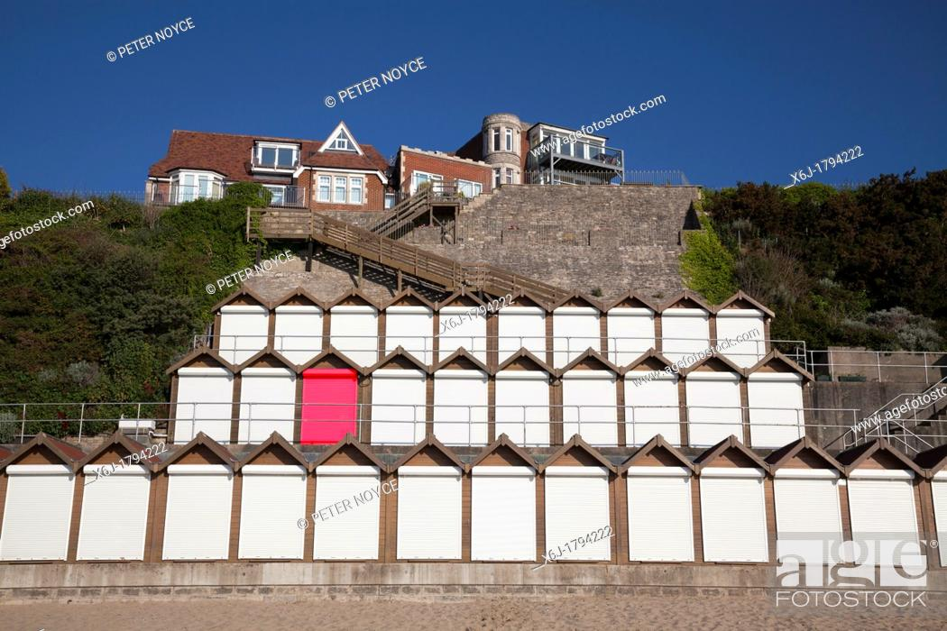 Stock Photo: Three levels of Beach huts with white roller shutter doors and one red door digitally created.