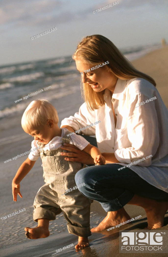Photo de stock: Mother and son at beach.