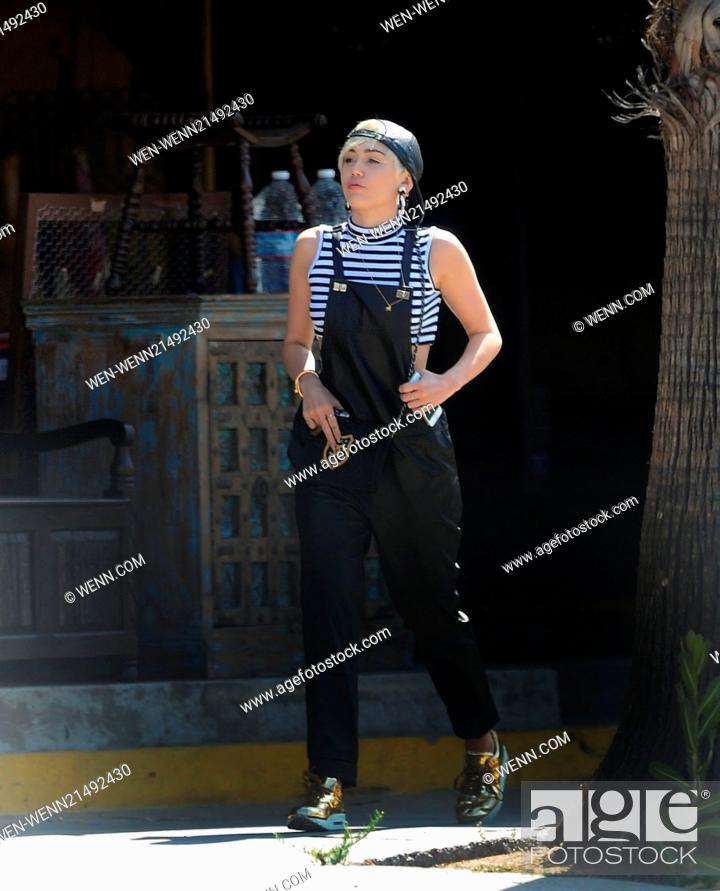 Miley Cyrus Wearing Black Leather Dungarees Accessorised With Chanel Handbag Gold Earrings Stock Photo Picture And Rights Managed Image Pic Wen Wenn21492430 Agefotostock