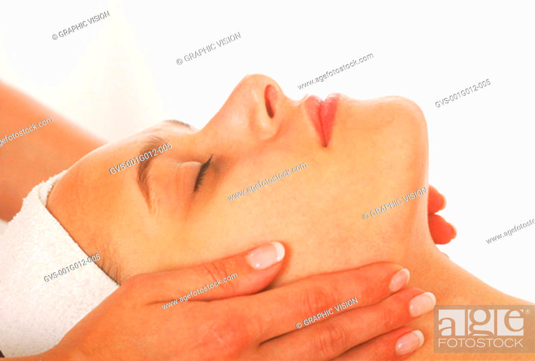 Stock Photo: Side profile of a woman getting a facial treatment.