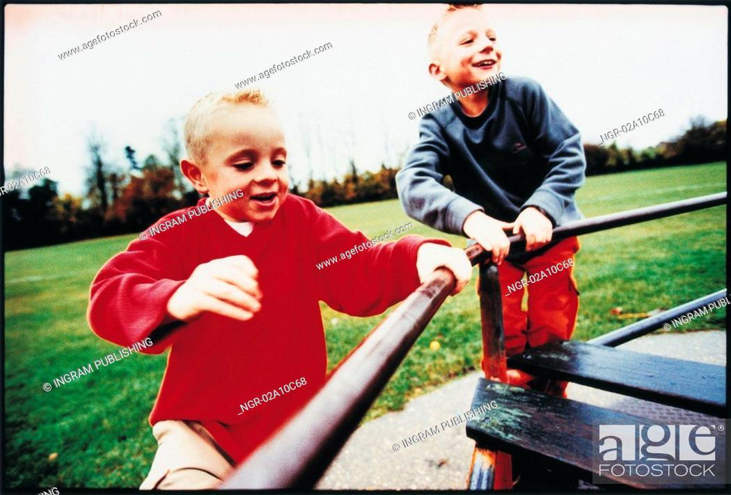 Stock Photo: kids playing at the playground.