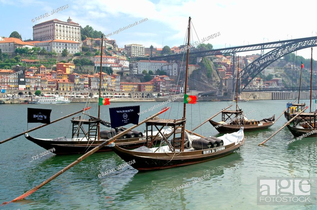 Stock Photo: Porto (Portugal). Typical vessels for the transport of barrels on the Douro River from the city of Oporto.