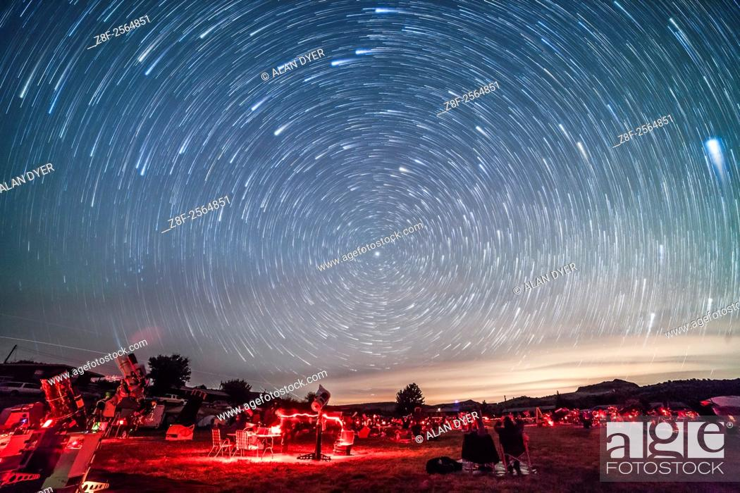 Stock Photo: Circumpolar star trails over the upper field of the Texas Star Party, May 13, 2015. The star party attracts hundreds of avid stargazers to the Prude Ranch near.
