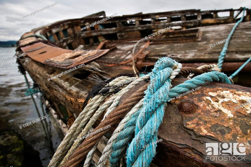Stock Photo: Ropes and cables hang from edge of abandoned fishing boat, near Salen, Isle of Mull, Scotland.