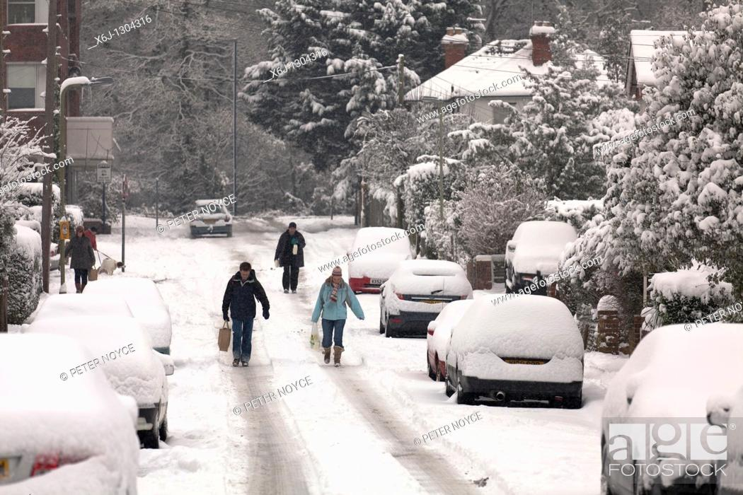 Stock Photo: Walking from the local shops with supplies when using a car is not possible during snow December 2010 in the south.