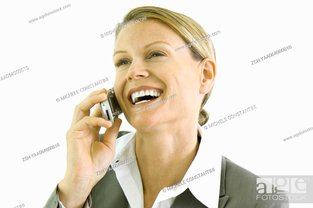 Stock Photo: Businesswoman using cell phone, smiling, looking away.