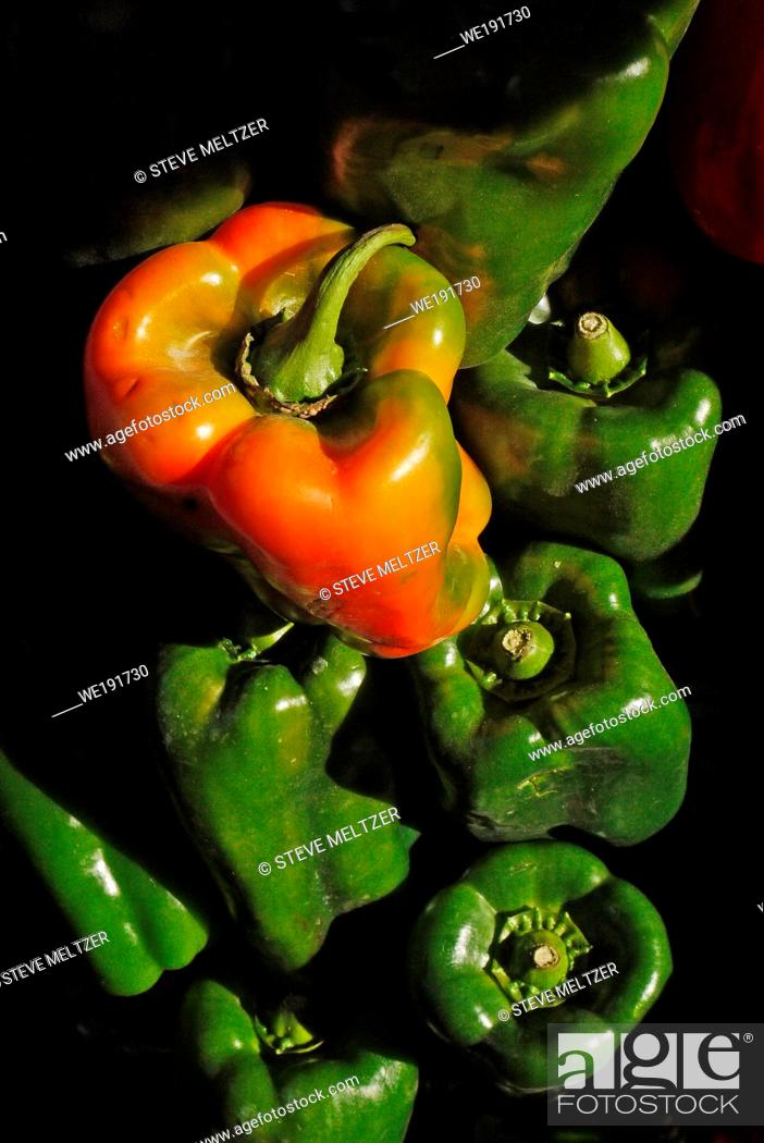 Stock Photo: As Green peppers ripen they turn into red.