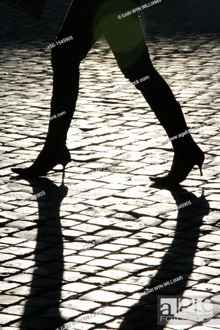 Stock Photo: detail of woman walking in street road city town.