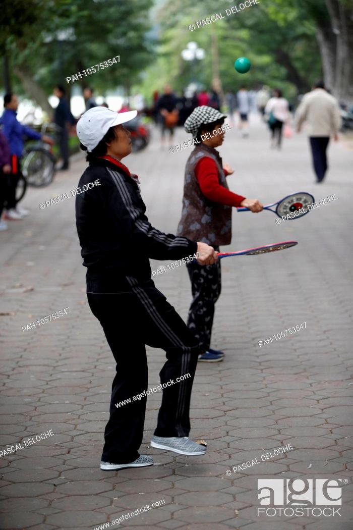 Stock Photo: Tai Chi Bailong Ball session along the banks of Hoan Kiem lake. Hanoi. Vietnam.   usage worldwide. - Hanoi/Hanoi/Vietnam.