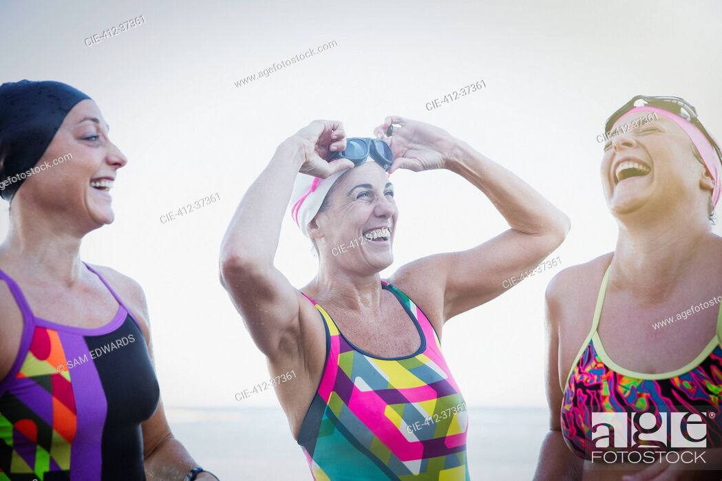 Stock Photo: Laughing female open water swimmers.