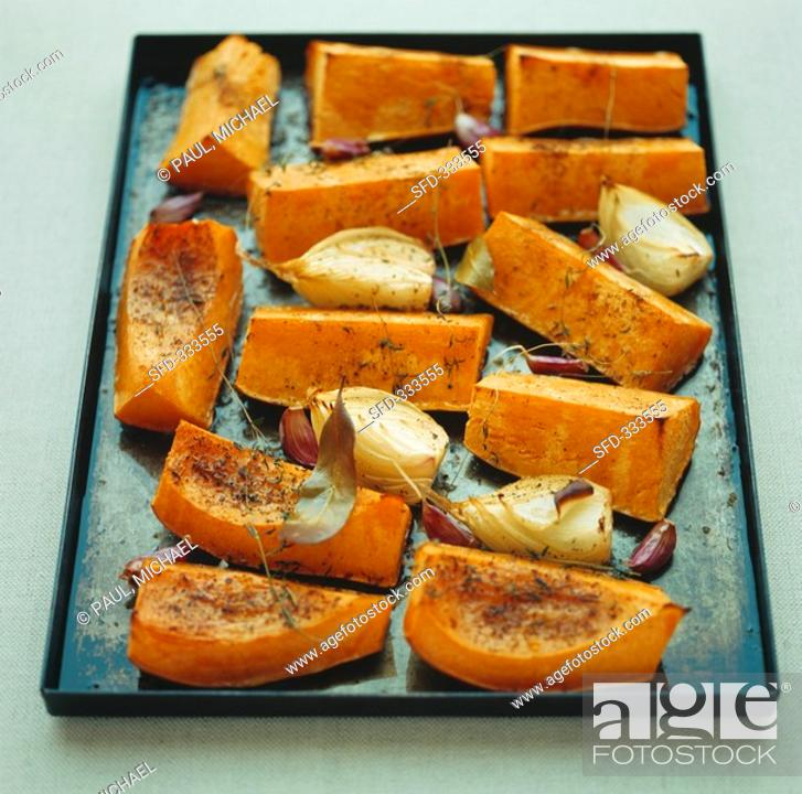 Stock Photo: Baked pumpkin slices with fennel and garlic.