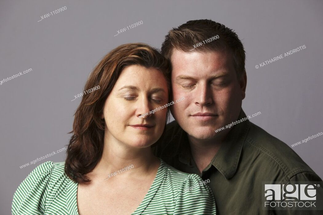 Stock Photo: Couple with eyes closed.